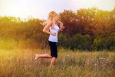 Fitness sport woman blonde running runner girl nature lifestyle — Stock Photo