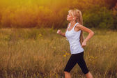 Fitness woman sport running runner nature girl lifestyle female — Stock Photo