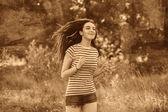 Brunette striped t-shirt runner woman young running outdoors, pr — Stock Photo