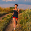 Photo: Beautiful healthy runs young brunette womathlete running ou