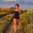 Beautiful healthy runs young brunette womathlete running ou — 图库照片 #28694299