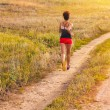 Road beautiful healthy brunette young woman athlete running outd — Stock Photo