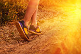 Sports a shoes female large legs running, exercising and walking — Stock Photo