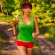 Beautiful healthy runs brunette young womathlete running ou — Foto de stock #29696387