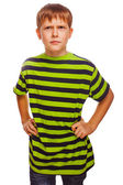 Blond gloomy serious boy in a green striped shirt thinking towar — Stock Photo