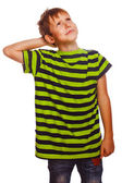 Blond boy in striped green shirt thinks scratching his head hair — Zdjęcie stockowe