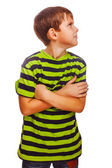 Sad child upset offended boy looking to the side in a green T-sh — Stock Photo