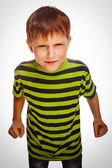 Angry child boy blond bully bad aggressive fights in striped gre — Stock Photo