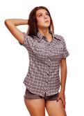 女性のブルネットの少女はい、親指の肯定的な兆候を示していますシャツ ショーツ — ストック写真