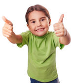 Baby girl emotions raised her thumbs up smiling symbol indicates — Stock Photo