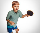 Boy blond man playing table tennis forehand takes topspin emotio — Stock Photo