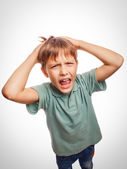 Boy child upset angry shout produces evil face portrait emotion — Stock Photo