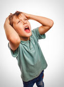 Child boy upset angry shout produces evil face portrait isolated — Stock Photo