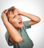 Child upset boy angry shout produces evil face portrait isolated — Stock Photo