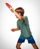 Ping pong boy blond man table tennis playing forehand takes tops — Stock Photo