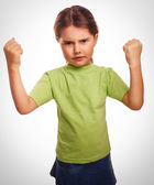 Angry child evil girl shows fists experiencing anger emotion — Stock Photo