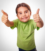 Baby girl emotions raised her thumbs up smiling symbol indicates yes emotions — Stock Photo