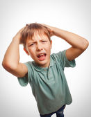 Child upset angry boy shout produces evil face — Stock Photo