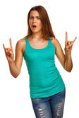 Woman shows sign devil rock metal girl in jeans — Stock Photo