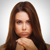 Brunette face woman girl covered her half hand isolated emotion — Stock Photo