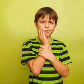Young boy child toothache pain in mouth, dental pain, holding hi — Stock Photo