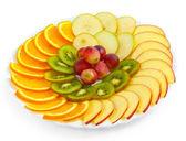 Apple kiwi grapes plate sliced isolated on white background — Stock Photo
