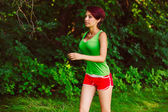 Beautiful a healthy runs young brunette woman athlete running ou — Fotografia Stock