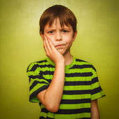 Young kid boy child toothache pain in mouth, dental pain, holdin — Stock Photo