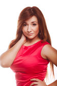 Sexy beautiful young woman girl in a red dress with long hair fa — Stock Photo