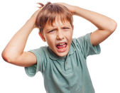 Boy child upset angry shout produces evil face portrait isolated — Stock Photo