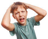 Child upset angry boy shout produces evil face portrait isolated — Stock Photo