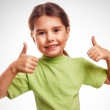 Baby girl raised her thumbs up isolated smiling symbol indicates — Stock Photo #41726505