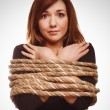 Stock Photo: Womprisoner tied rope hostage female bondage bound girl slave