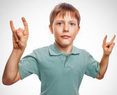 Boy kid teenager shows gesture hands metal rock devil isolated o — Stock Photo