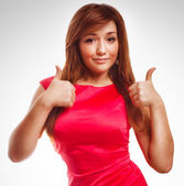 Brunette girl yes woman shows positive sign thumbs isolated emot — Stock Photo