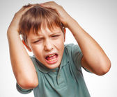 Boy child upset angry shout produces isolated evil face portrait — Stock Photo