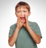 Calling boy kids cries shouts teenager opened his mouth isolated — Stockfoto