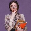 Girl woman brunette teacher in glasses with books surprised open — Stock Photo #44168603