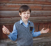 Teenager boy angry unhappy swears, waving his arms family relati — Stock Photo