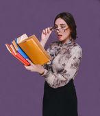 Woman girl brunette teacher in glasses books surprised opened he — Stock Photo