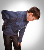 Gray osteochondrosis teenage holds boy teenager his hand behind — Stock Photo