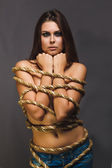 Brunette hostage, captive woman bound with rope prisoner in jean — Stock Photo