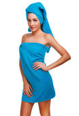 Woman slim thin curly girl brunette in blue towel after bath sho — Stock Photo