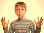 Blond portrait man raised his hands up baby boy surprised in a s — Stock Photo