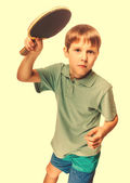 Boy athlete child teenager with racket plays table tennis ping p — Stock Photo