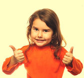 Curly brunette girl holding child shows thumb yes agreement isol — Stock Photo