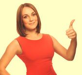 Happy young woman girl shows positive sign thumbs yes, in an ora — Stock Photo
