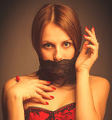 Woman girl in a red corset, her mouth covered with bandage — Stock Photo