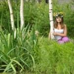 Beautiful young woman near the birch — Stock Photo