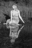 Beautiful young woman in sundress — Stock Photo